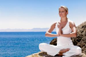 Beautiful girl meditating in yoga pose